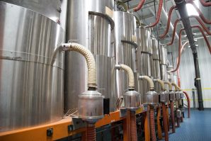 Centralized material feed and dryer stations to assure purity and quality